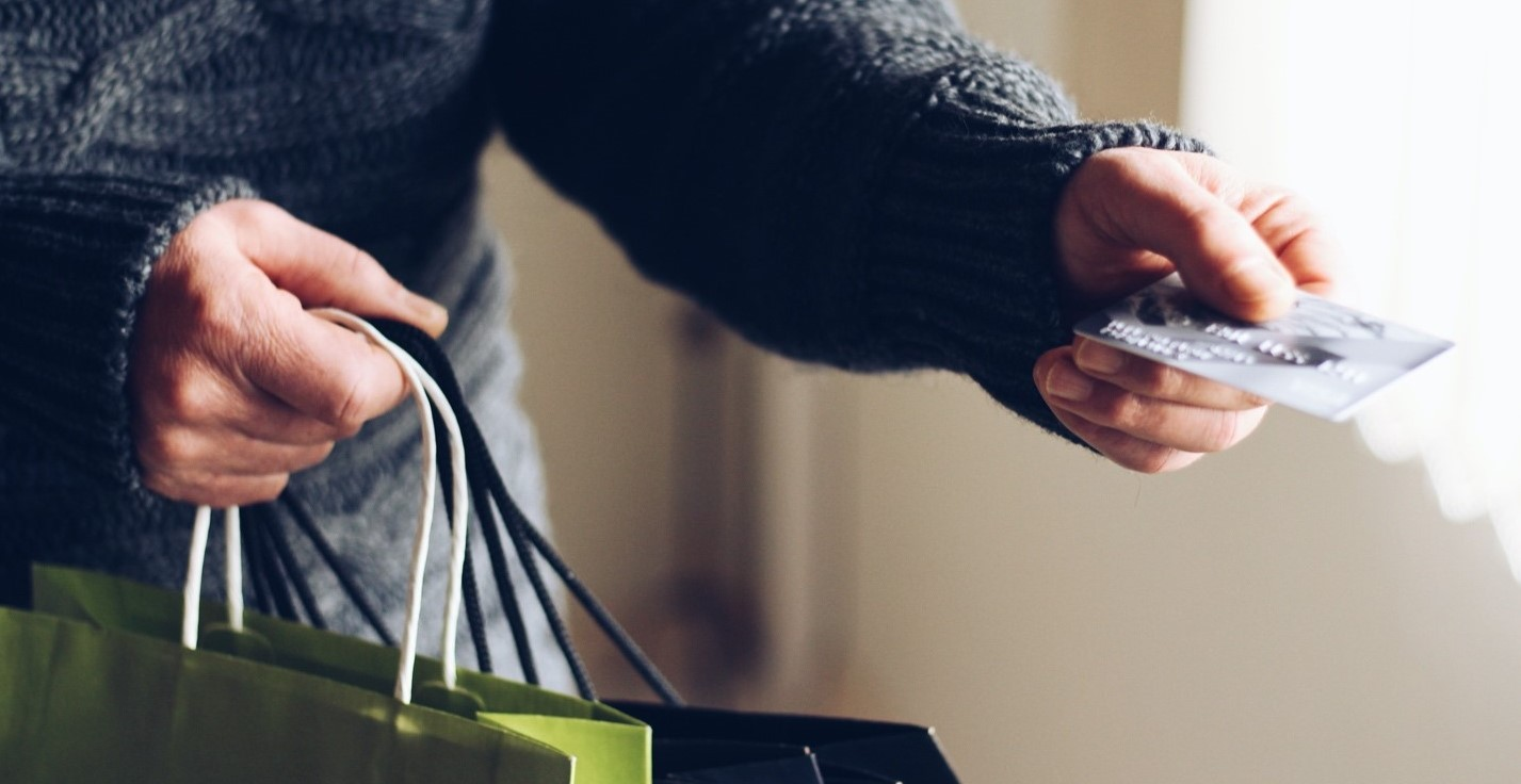 Man with credit card holding shopping bags